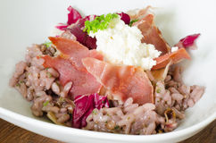Red wine risotto with fried ham Royalty Free Stock Photography