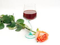 Red wine and rose. Red wine in a glass and a rose Royalty Free Stock Images