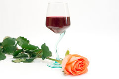 Red wine and rose. Red wine in a glass and a rose Royalty Free Stock Photo