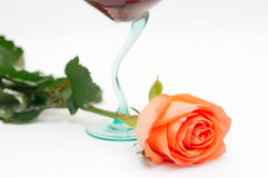 Red wine and rose. Red wine in a glass and a rose Stock Photo