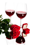Red wine, rose and wedding rings Stock Images