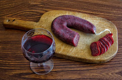 Red wine and salami Stock Image