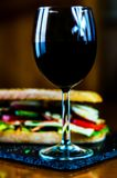 Red Wine and sandwich, dry wine perfect for eating. A gourmet set Royalty Free Stock Photos