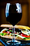 Red Wine and sandwich, dry wine perfect for eating. A gourmet set Stock Image