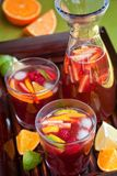 Red wine Sangria. On wooden tray royalty free stock photos