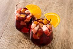 Red wine sangria in glasses on wood. En table stock images