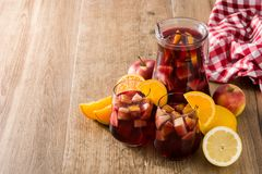 Red wine sangria in glasses. On wooden table. Copyspace stock images