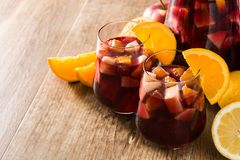Red wine sangria in glasses. On wooden table. Copyspace royalty free stock photos