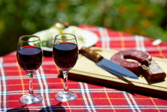 Red wine and sausage Royalty Free Stock Images