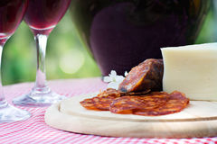 Red wine and sausage with cheese Stock Images