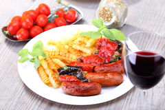 Red wine and sausage with potato Stock Photography