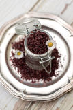 Red wine sea salt in a jar with flowers Royalty Free Stock Photos