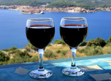 Red wine sea view Stock Images
