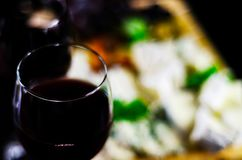 Red wine and set of different cheeses on a wooden board, delicio. Us snack, healthy and exclusive food Royalty Free Stock Photos