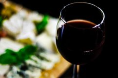 Red wine and set of different cheeses on a wooden board, delicio. Us snack, healthy and exclusive food Stock Image
