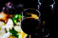 Red wine and set of different cheeses on a wooden board, delicio. Us snack, healthy and exclusive food Stock Photo