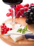 Red wine, sheep cheese and grapes. Isolated on white background Stock Image