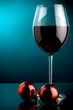Red wine shot and Christmas decoration Royalty Free Stock Image