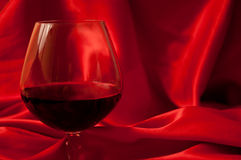 Red wine and silk Royalty Free Stock Photos