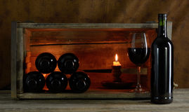 Red wine. Six bottles and a glass of red wine Stock Photo