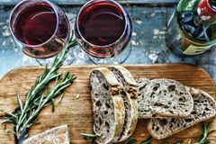 Red wine and snacks. Christmas, Thanksgiving, wine, Parmesan, rosemary, bread. Flat position, top view, closeup. stock photography