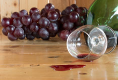 Red wine spilled and grapes fruit Royalty Free Stock Images