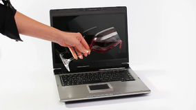 Red wine spilled over notebook Royalty Free Stock Images