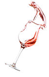 Red wine spilling. All over the place, isolated on white background Royalty Free Stock Photo