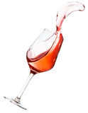 Red wine spilling. All over the place, isolated on white background Royalty Free Stock Image