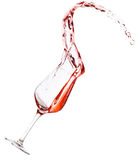 Red wine spilling. All over the place, isolated on white background Stock Photography