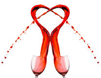 Red wine spilling and forming heart shape Stock Image