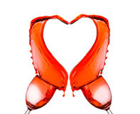 Red wine spilling and forming heart shape Royalty Free Stock Photo