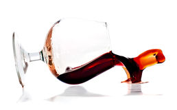 Red wine spilling from a transparent glass Royalty Free Stock Images