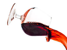 Red wine spilling from a transparent glass Royalty Free Stock Photo
