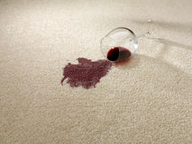 Red wine spilt on carpet Stock Photos