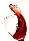 Red Wine Splash. Red wine leaping and splashing from a wine glass Royalty Free Stock Image