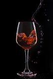 Red wine splash Stock Photography