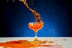 Red wine splash Stock Images
