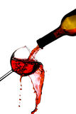 Red wine splash. In glass isolated on white background Royalty Free Stock Photos