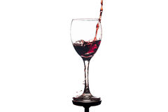 Red wine splash in glass Royalty Free Stock Image