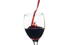 Red wine splash in glass Stock Images