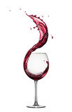 Red wine splash. Glass of splashing red wine isolated on white Royalty Free Stock Photos