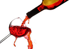 Red wine splash. Red wine poured in a glass isolated on white background Royalty Free Stock Images