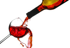 Red wine splash. Red wine poured in a glass isolated on white background Royalty Free Stock Image