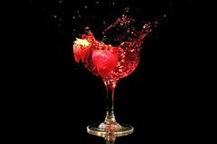 Red wine splash with strawberries Stock Images