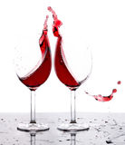 Red wine splash in two glasses Stock Image