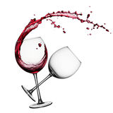 Red wine with splashes. Glass of splashing red wine and an empty glass stock photography
