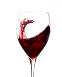 Red wine splashing in glass. Side view of red wine splashing in glass, isolated on white background Stock Images