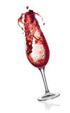 Red wine splashing from glass. Royalty Free Stock Image