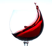 Red wine splashing in grass Stock Photos